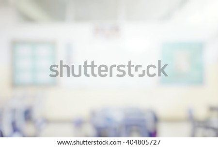 Blur abstract background of kindergarten classroom. Blurred image of empty elementary room. Blurry view of primary class without student  or teacher with chairs and tables