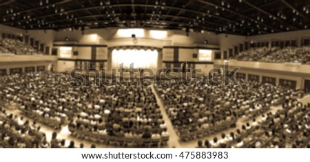 Blur abstract background panorama audience in hall during graduation ceremony. Blurry new students for freshman orientation day.Defocus event university or campus conference room in sepia vintage tone