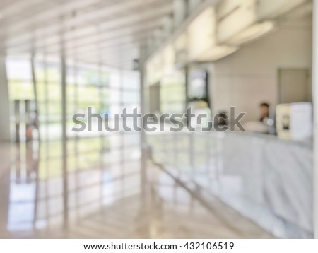 Blur abstract background reception hall customer or patient counter service & cashier desk indoor space in hospital office hotel bank interior: Blurry perspective view information lobby staff working