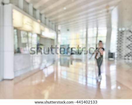 Blur abstract background reception hall customer or patient counter service & cashier desk indoor space inside hospital office hotel bank: Blurry perspective view information lobby in medical center