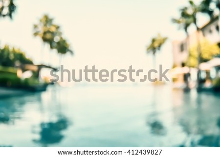 Blur abstract background vintage style resort hotel swimming pool reflective water surface, blue cool clear sky, coconut palm tree row: Blurry perspective view vacation summer holiday relaxation pond