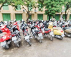 Blur abstract of a university parking lot with varieties of motorcycles in many brands and colors. Vietnam is the world second highest motorcycle-owning country with more than 42mil registered ones.