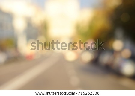 blur abstract people background, unrecognizable silhouettes of people walking on a street #716262538