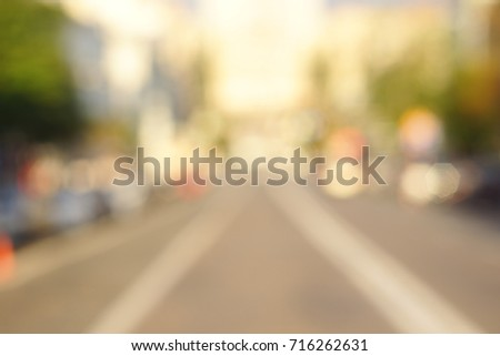 blur abstract people background, unrecognizable silhouettes of people walking on a street #716262631