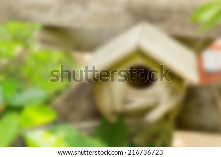 blur abstract wooden bird house in nature garden background