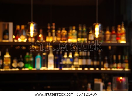 blur alcohol drink bottle at club pub or bar in dark party night background #357121439