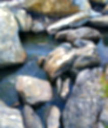 blur and defocused mini waterfall in Switzerland with black rocks for travel concept background, Blurred images of waterfalls in Europe,