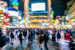 Blur and movement shot of Pedestrians crosswalk at Shibuya district in Tokyo, Japan
