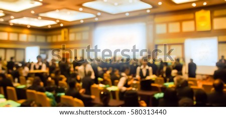 Blur audience  in hall  or auditorium or  classroom with screen