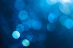 blur background abstract blue color. defocused glittering of glitter beautiful colorful soft effect pattern design for backdrop or wallpaper.