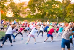 Blur background group man and women  dancing a fitness dance or aerobics in an old park