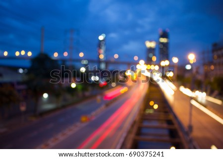 Blur background image. background is blur of light from street at night. #690375241