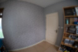 Blur background image of modern room with wooden shelf  interior taken with a fisheye lens
