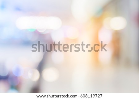 blur background image of shopping mall or department store with bokeh and people background usage concept