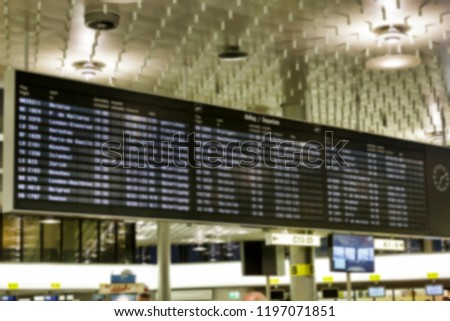Blur, background image. Scoreboard with flights at the airport. #1197071851