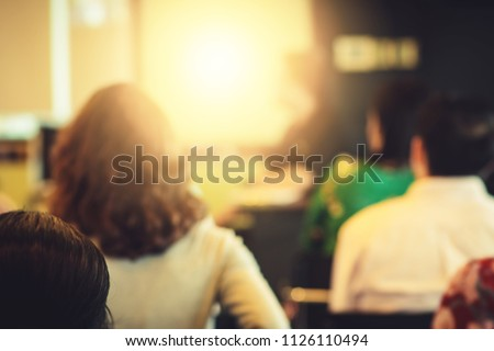 Blur background of happy and fun professional successful business conference town hall meeting use in employee workshop learning, training, lecturing, seminar to create creativity, idea and planning #1126110494