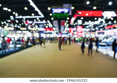 blur background of international motorshow, Bangkok , Thailand. car show room. Abstract blurred image people in international cars exhibition.