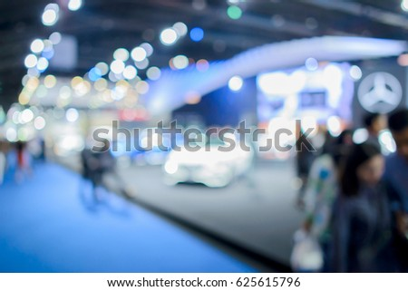 blur background of international motorshow, Bangkok , Thailand. car show room. Abstract blurred image people in international cars exhibition show in thailand.