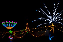 Blur background of light beam of fluorescent light colorful show of temple festival fair at Thailand