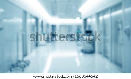 blur background of modern hospital ICU corridor interior, medical and healthcare concept