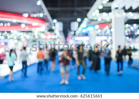 blur background of motorshow, car show room. Abstract blurred image people in cars exhibition show.