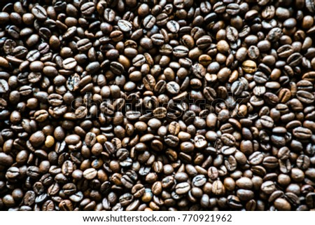 blur background of organic roasted coffee beans #770921962