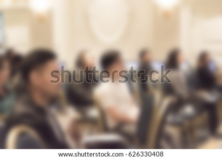 blur background of people at meeting and exhibition room hall with business people #626330408