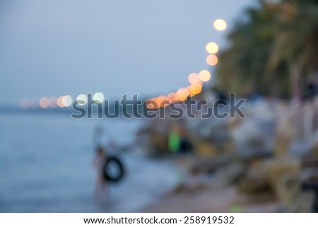 Blur background of people in the sea in evening with bokeh.