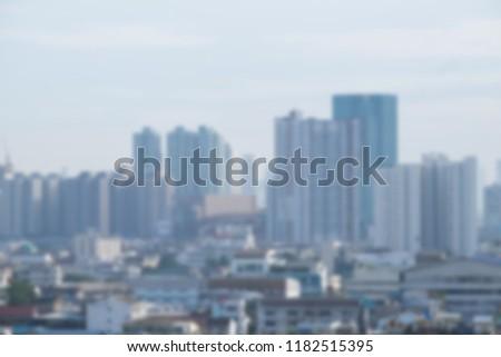 Blur background of skyscraper building condominium apartment office and residential in big city. #1182515395
