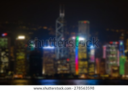 Blur background with illuminated buildings of skyscrapers at night time