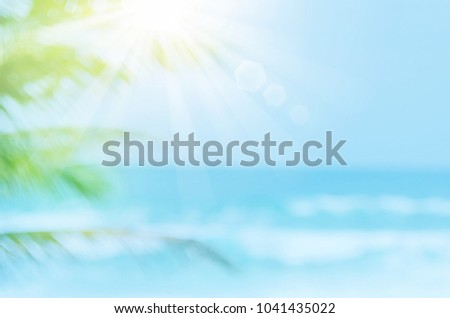 Blur beautiful nature green palm leaf on tropical beach with bokeh sun light wave abstract background. Copy space of summer vacation and business travel concept. Vintage tone filter effect color style - Shutterstock ID 1041435022
