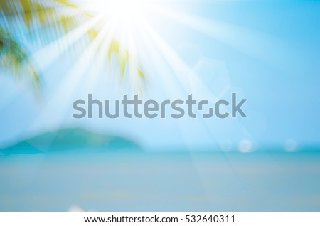 Blur beautiful nature green palm leaf on tropical beach with bokeh sun light wave abstract background. Copy space of summer vacation and business travel concept. Vintage tone filter color style. - Shutterstock ID 532640311