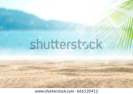 Blur beautiful nature green palm leaf on tropical beach with bokeh sun light wave abstract background.  - Shutterstock ID 666120412