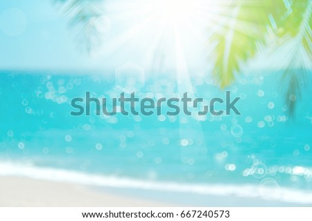 Blur beautiful nature green palm leaf on tropical beach with bokeh sun light wave abstract background.   #667240573