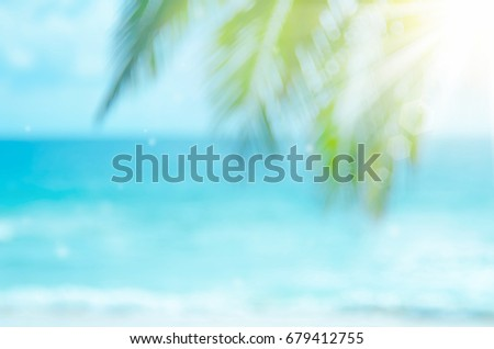 Blur beautiful nature green palm leaf on tropical beach with bokeh sun light wave abstract background. Copy space of summer vacation and business travel concept. Vintage tone filter effect color style - Shutterstock ID 679412755