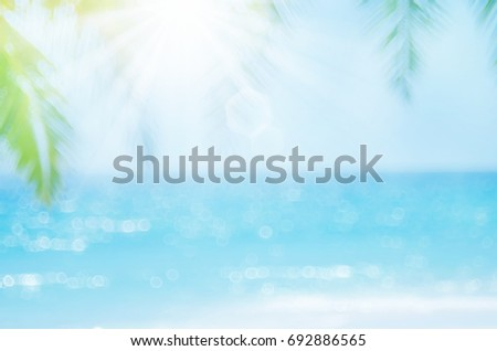 Blur beautiful nature green palm leaf on tropical beach with bokeh sun light wave abstract background. Copy space of summer vacation and business travel concept. Vintage tone filter effect color style - Shutterstock ID 692886565