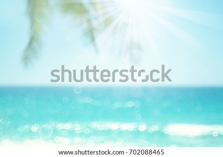 Blur beautiful nature green palm leaf on tropical beach with bokeh sun light wave abstract background. Copy space of summer vacation and business travel concept. Vintage tone filter effect color style - Shutterstock ID 702088465