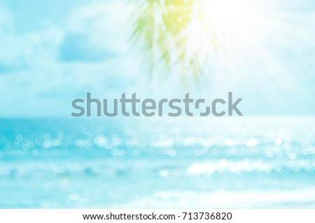 Blur beautiful nature green palm leaf on tropical beach with bokeh sun light wave abstract background. Copy space of summer vacation and business travel concept. Vintage tone filter effect color style - Shutterstock ID 713736820