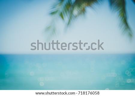 Blur beautiful nature green palm leaf on tropical beach with bokeh sun light wave abstract background. Copy space of summer vacation and business travel concept. Vintage tone filter effect color style - Shutterstock ID 718176058