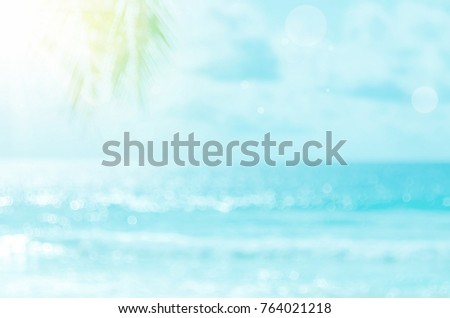 Blur beautiful nature green palm leaf on tropical beach with bokeh sun light wave abstract background. Copy space of summer vacation and business travel concept. Vintage tone filter effect color style - Shutterstock ID 764021218