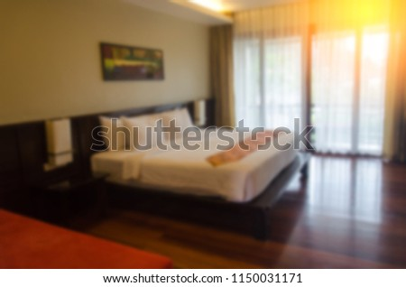 blur bedroom interior for background.can be used for display