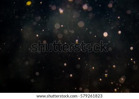 Blur bokeh of light on black background - Shutterstock ID 579261823
