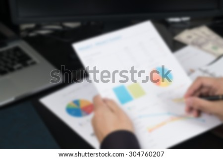 blur businessman hand checking his profit on account work table .for business background #304760207