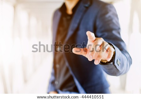 Blur businessman pushing on a touch screen interface