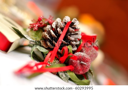 Blur christmas decoration with  candle and cone on the holiday table, background