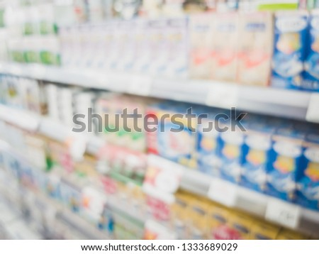 Blur close up of milk product on a shelf in a convenience store to be sell to consumer #1333689029