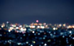 Blur colorful bokeh night city landscape background.