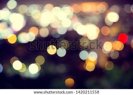 Blur defocus bokeh of light in the city with dark background #1420211558