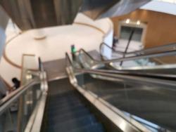 Blur focus of Escalator going down. Escalator in department store. Modern escalator