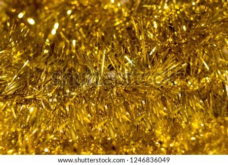 blur golden tinsel background. gold tinsel defocused background  #1246836049